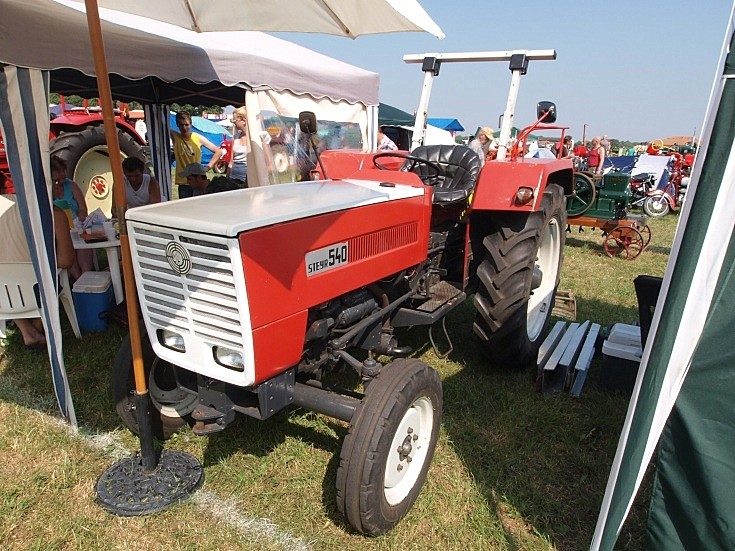 Red and white tractor