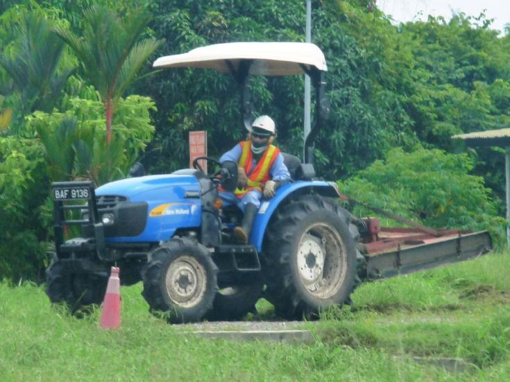 New Holland grass cutting tractor