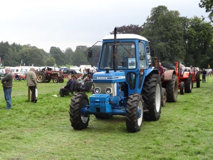 Line up of classic tractors headed by County