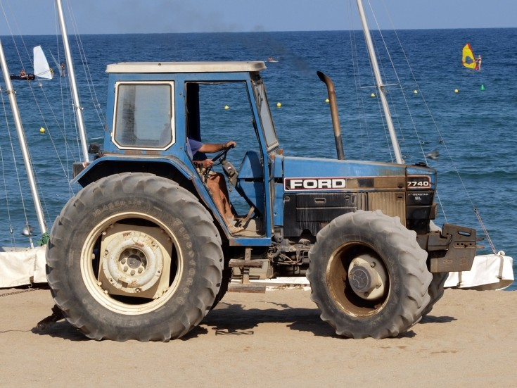 Ford 7740 at the beach in Barcelona, used for towing sailboats.