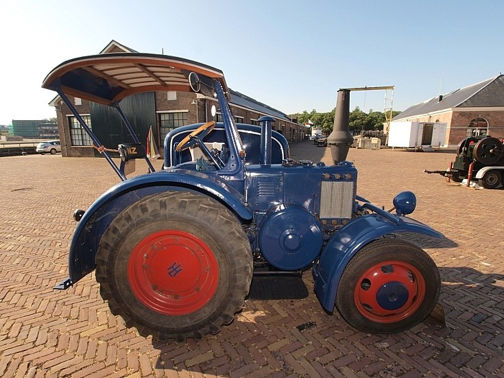 Side view of an unidentified restored tractor